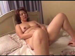Japanese,Mature Mature Japanese bimbo with huge tits...